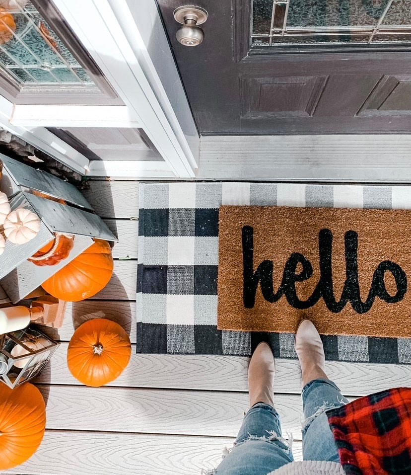 Fall front porch with gingham mat and hello mat