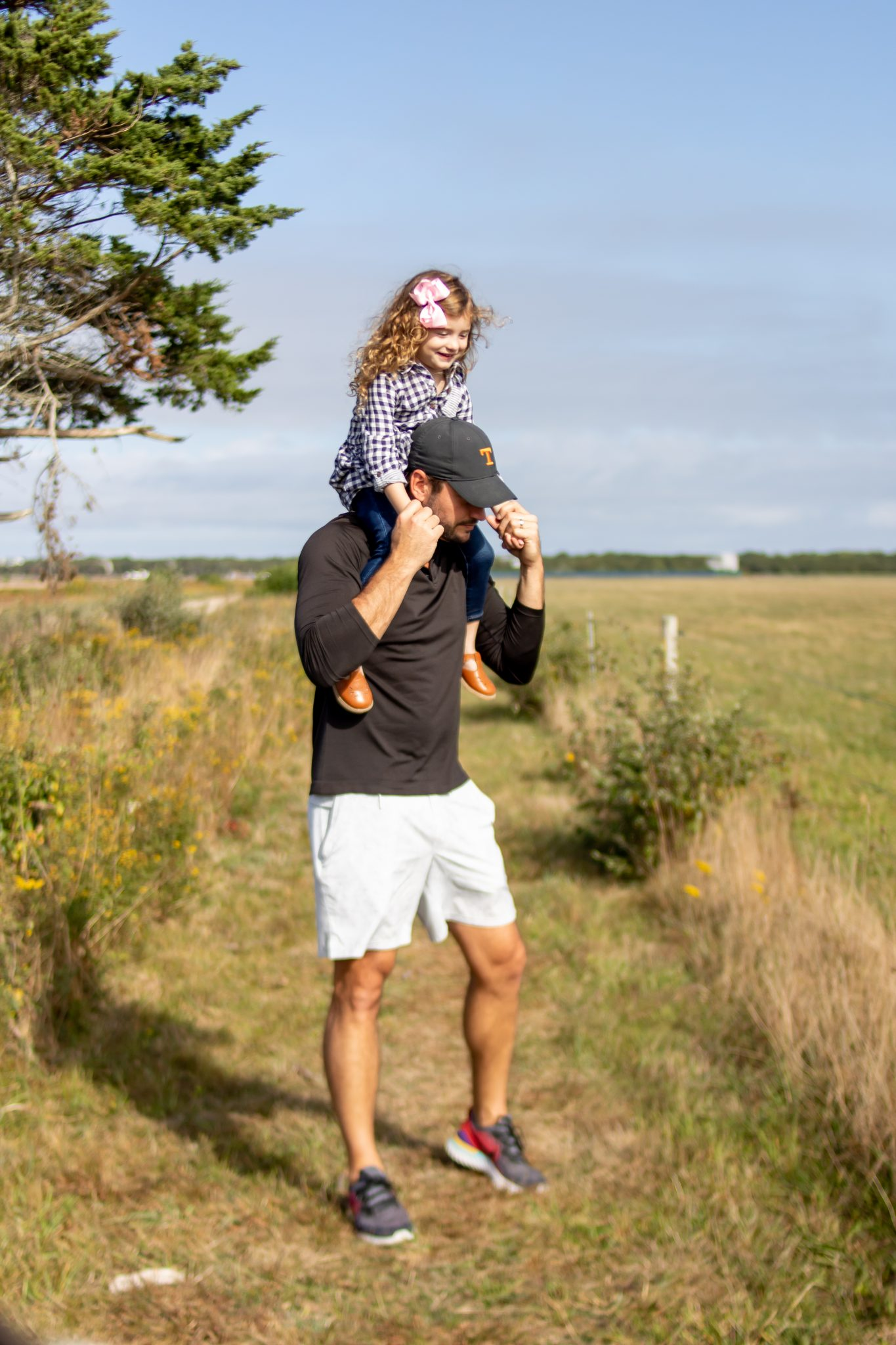 little girl on dad's shoulders at Katama Airfield