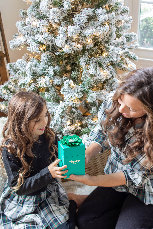 Mom giving little girl Tieks for Christmas
