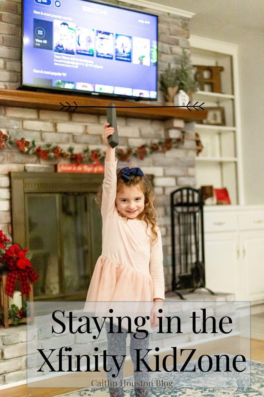 little girl holding xfinity remote kidzone on tv